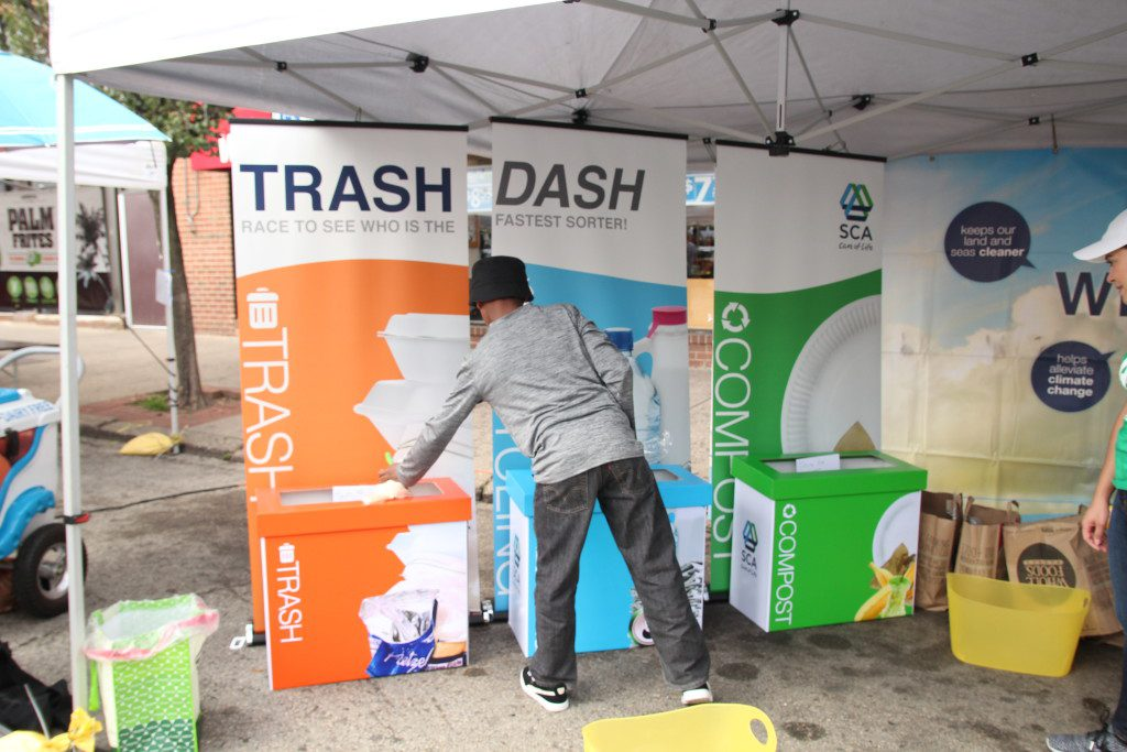 Participants race to sort trash, compost, and recycling for SCA's Trash Dash game at Greenfest.